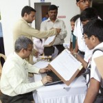 Students swarming the registration desk handled by Ramachandranji & Sriramji